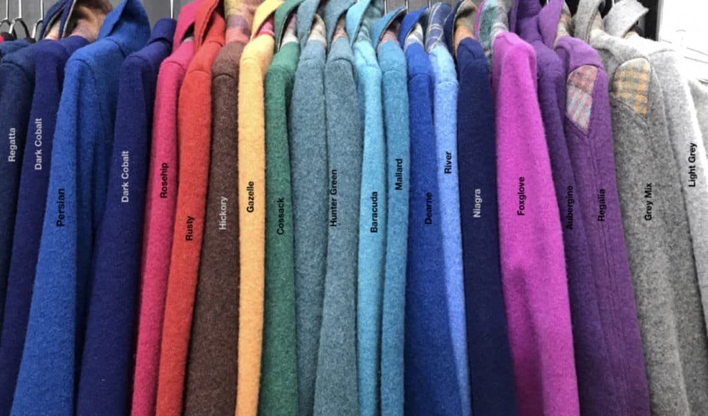 All the colours shown in a row of jackets . From Navy's to greys .