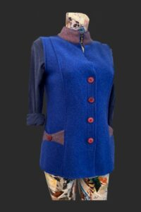 Semi fitted waistcoat in blue with tweed trim and red buttons. Blue gilet, waistcoat wool