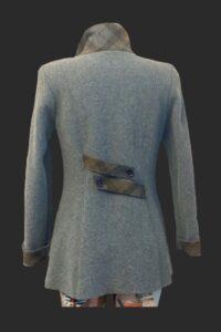 Back picture caspian 3/4 jacket with belt detail.