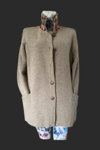 Loose jacket for shopping and walking lots of pocket space. Stand collar with tweed trim.