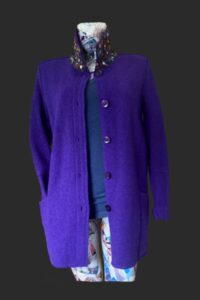 Loose fitting wool jacket  with big pockets great for shopping and walking. Trim on collar and pockets in sleeves