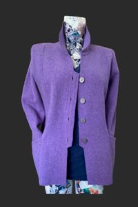 Casual semi fitted smart jacket with pockets. Button detail on the back.