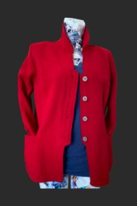 Quirky back detail to this red wool jacket, button fastening , big pockets. Red wool jacket, Red jacket