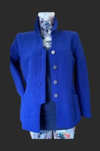 Semi fitted jacket with button detail on the back.