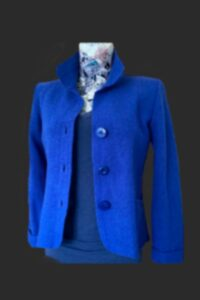 Fitted short wool jacket. Wool jacket, three buttoned, pockets, blue wool jacket