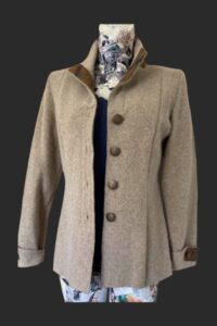 Highlander jacket fitted with back pleat set from the mid hip down. Tweed trim on cuffs collar and neckline.