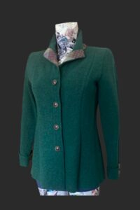 Smart fitted jacket with tweed trim on the collar back belt and cuffs. 4 button fastening in marked green