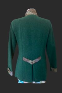 Back view of Cossack jacket showing the belt and pleat detail set just below the waist line.