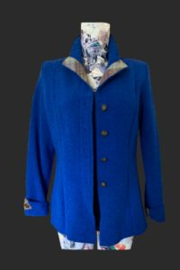 Lovely fitted highlander jacket in Dearne blue . Tweed trim on collar cuffs and belt detail .