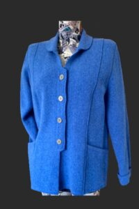 Semi fitted jacket with lots of button detail on the back . In river blue