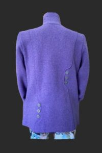 Back view of quirky military with the asymmetrical button detail .