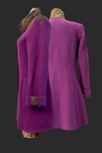 Rich foxglove pinky purple fitted coat. Tweed triangle inserts on the sleeve head and cuff. Tweed trim on the collar . Big pockets.