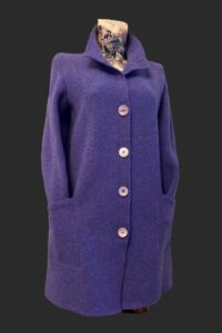 Lovely soft purple a line coat with big pockets. Fits neatly on the shoulders and hangs beautifully .
