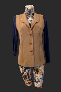 Fitted waist coat with v roll collar. Simple plain and warm