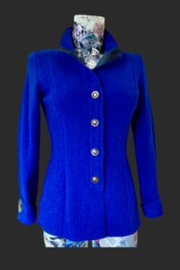 Fitted smart jacket sapphire blue with tweed trim. Back low pleat and mock belt detail.